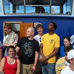 Cambridge '05 Director Michael Hemesath with students on boat ride down the Thames River