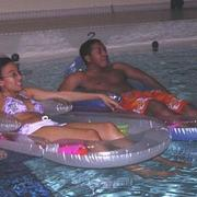 "Students recline at Cowling Pool to watch ""Finding Nemo."""