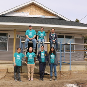 ASB group poses in front of Habitat home.
