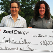 Carleton Director of Cowling Arboretum Nancy Braker (left) and Pamela Gorman, Xcel Energy Manager of Community Relations