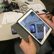 Image of a student using the BiochemAR app on an iPad.