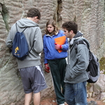 Noah, Rose, and David examine ripple casts in the Baraboo quartzite.