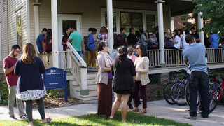 2016 Ice Cream Social. TRIO Students and Staff in front of TRIO House socializing and eat ice cream.
