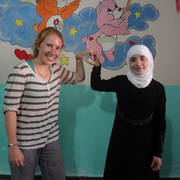 Ulbricht posing with a young teacher at the Reyhanli children's center