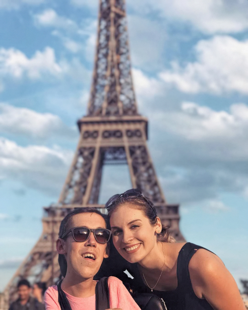 Aylward and Burcaw pose at the Eiffel Tower