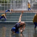 Dancers performing in a fountain