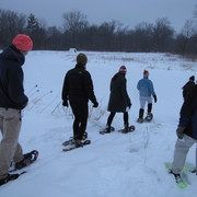 Students snowshoeing in the Arb.