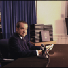 Richard Nixon at his desk.