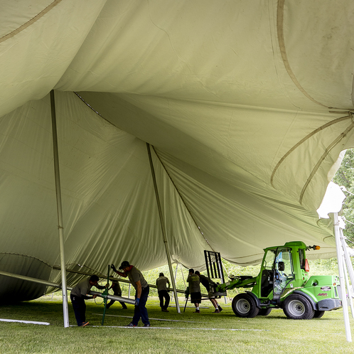 Setting up a tent at Reunion 2019