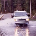 Van splashing through the waters of the flooded Devil's Lake on a field trip to Baraboo, Wisconsin, Fall 2002.