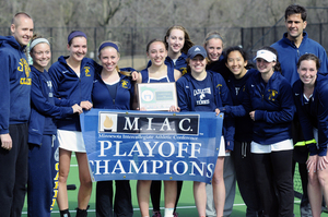 Head Coach Luciano Battagalini and the women's tennis team celebrate the 2014 MIAC title