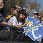 Fans cheer from the stands at the Carleton vs. St. Olaf Football Game