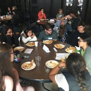 Students discuss engagement over lunch.