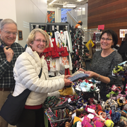History professor emeritus Cliff Clark & his wife Grace shop at the 2018 holiday craft fair.