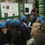 Physicist talking with students about the MINOS detector