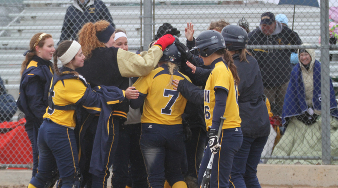 The Knights celebrate a home run by Jenny Ramey.