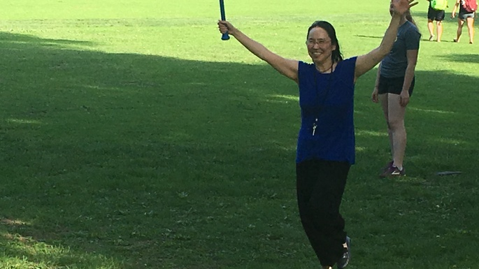 Assoc. Professor Asuka Sango is a wiffle ball master at the Religion picnic (May 2018)