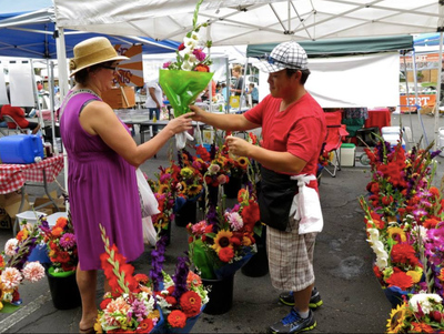 Selling flowers at a farmers' market