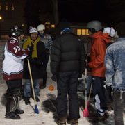 Dean Livingston and President Poskanzer participate in a fun and exciting game of broomball with students.