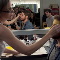 Lecturer Mary Ann Kelling demonstrates make-up application in a Weitz Center dressing room.