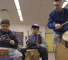 Nick Leeke '18 teaches children African drumming at Greenvale Elementary School.
