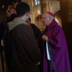 Archbishop Flynn greets students after Mass.