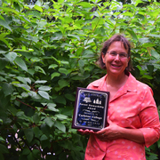 Arboretum director Nancy Braker with Carleton's 2015 Forest Stewardship Award