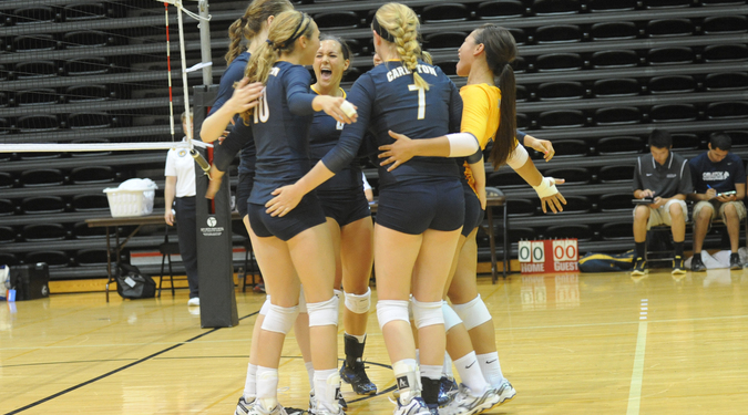 The Carleton volleyball team celebrates their sweep on day two of the Macalester Invite