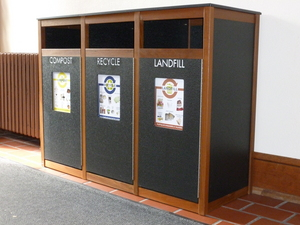 A Centralized Waste Station in Laird. Compost, recycling, and trash bins are always co-located.