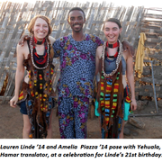 Seniors Lauren Linde and Amelia Piazza celebrate with the Hamar Tribe in Ethiopia.