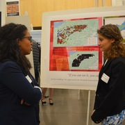 Students share their internship experiences at a poster session dinner.