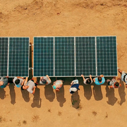 Carleton students install a solar energy system on a farm in India.