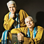 Portrait of Hindustani vocalists Pandits Rajan and Sajan Misra.