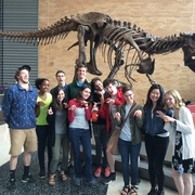 Carleton students pose as dinosaurs at Science Museum