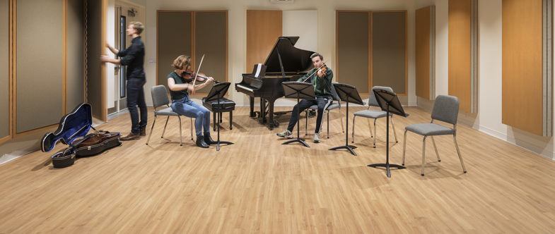 Student violinists and cellist rehearse in Puzak Chamber Studio in the Weitz Center for Creativity.