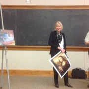 Alison presented with painting by David Lefkowitz, former student/faculty colleargue