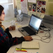 Angely Guevara '16 works at her desk during a summer internship at Mullen Lowe Advertising.