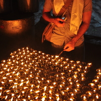 Lighting candles at Mahabodhi Temple