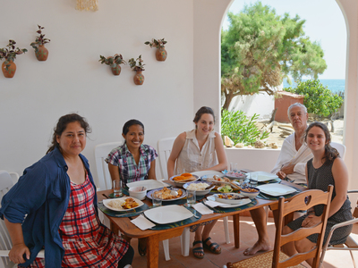 Constanza Ocampo-Raeder, left, enjoys a meal with her students in Peru.
