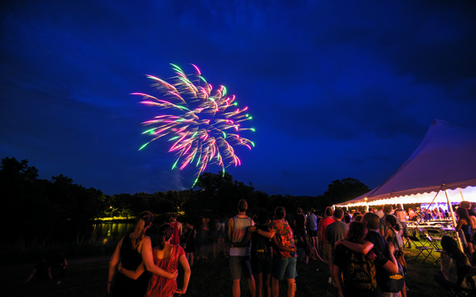 Alumni watch fireworks over Lyman Lakes during Reunion 2018
