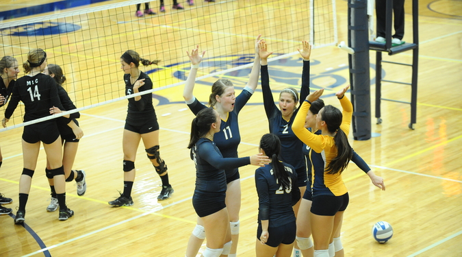 The Carleton volleyball team celebrates a perfect weekend at the ACM Tournament