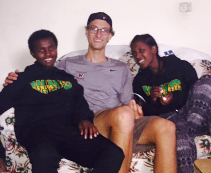 Jonas Lindholm-Uzzi (center) with two students from the school in Ethiopia at which he volunteered.