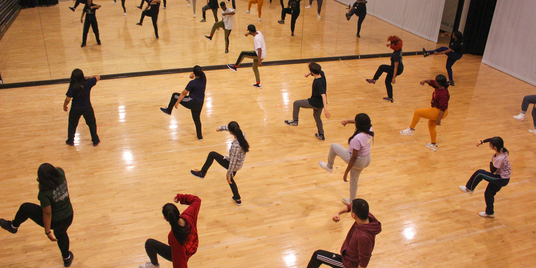 Hip-hop choreographer Herb Johnson III works with students in the Winter Dance 2019 course.