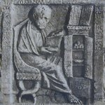 Roman relief of scholar with book chest.