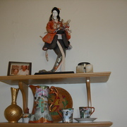 A doll and tea set given to Dacie by an alum with Japanese ancestry.