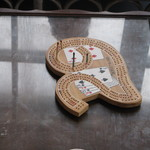 The cribbage board.