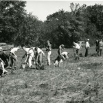 Tree Planting lead by Harvey Stork. From the Cowling Arboretum Digital Archives.
