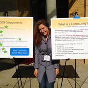 Kathryn Lozada (Class of 2012) with posters about Greenvale Park Community School.