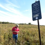 Tour of a prairie restoration test site at Central College, hosts of the 2017 UMACS Conference.