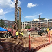 Two vertical bore rigs staffed by 3 workers each drilling geothermal bores on the Mini Bald Spot.